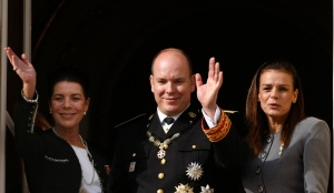 Prince Albert II of Monaco waves from the Palace balcony during a parade for Monaco's National Day in Monte Carlo