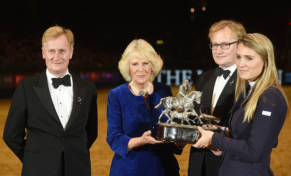 LONDON, ENGLAND - DECEMBER 17: Camilla, Duchess of Cornwall presents the Raymond Brooks-Ward Memorial Trophy to winner Jessica Mendoza during The London International Horse Show at Olympia Exhibition Centre on December 17, 2015 in London, England. (Photo by Stuart C. Wilson - WPA Pool /Getty Images)